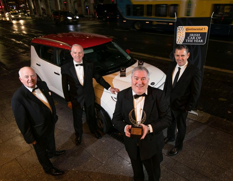 Anthony Conlon, Irish Car of the Year Committee; Tom Dennigan, Continental Tyres; Ronan Flood, MD of Kia Motors Ireland; and Bob Flavin, Irish Car of the Year Committee; with the Kia e-Soul.