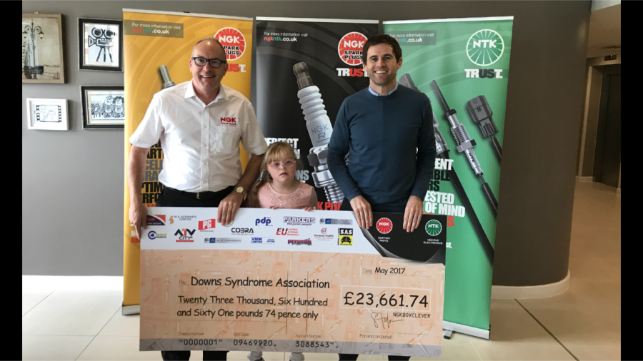 NGK Sales Manager presents cheque to Down's Syndrome Association